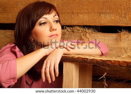 Portrait of pensive girl in red shirt, in village building. Clos Stock photo © Paha_L