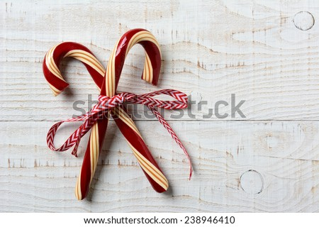 Closeup of two old fashioned candy canes on a rustic wooden back stock photo © vlad_star