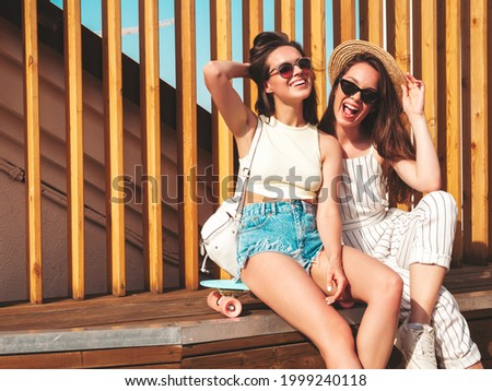 Sexy woman posing with skateboard Stock photo © deandrobot