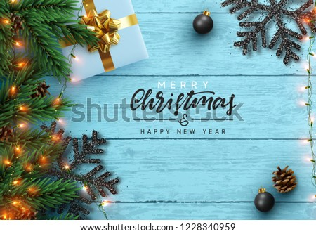 christmas tree branches on blue wooden texture ready for your de stock photo © vlad_star
