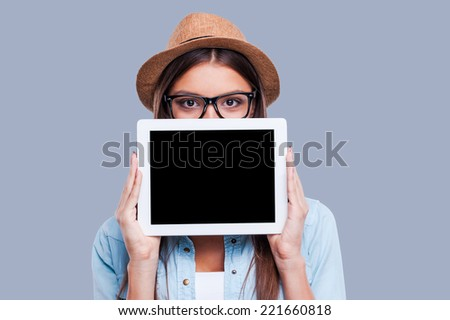 Beautiful woman holding a digital tablet in front of her face Stock photo © wavebreak_media