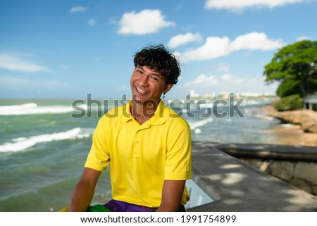 man with a rainbow flag in front of the ocean Stock photo © nito