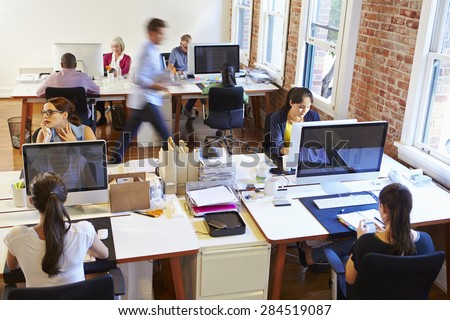 A man is sitting in the office at the desk, talking on the phone and working with documents and a ca Stock photo © Traimak