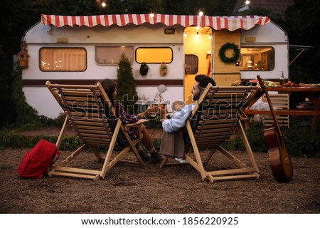 Woman with a man resting near motorhomes in nature. Family vacat Stock photo © cookelma