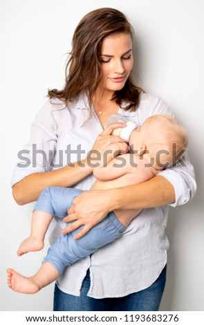 A mother holdng his baby on studio white background stock photo © Lopolo