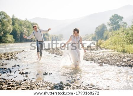 Gyönyörű káprázatos menyasszony elegáns jóképű vőlegény Stock fotó © ElenaBatkova