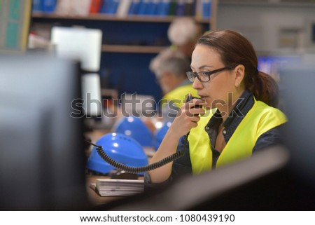 Young woman controlling process in the factory with male worker Stock photo © boggy
