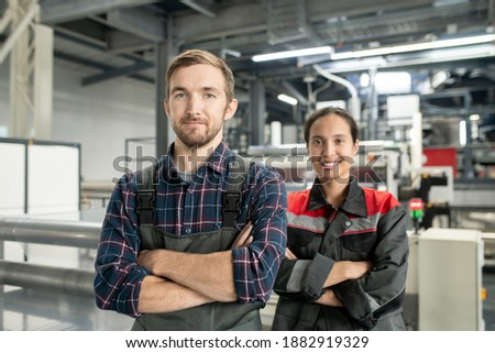 Two young engineers of large processing factory working in warehouse Stock photo © pressmaster