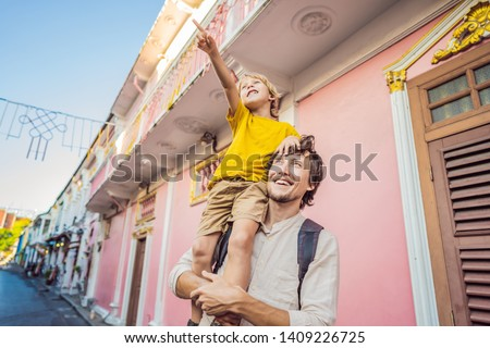 Dad and son tourists on the Street in the Portugese style Romani in Phuket Town. Also called Chinato Stock photo © galitskaya