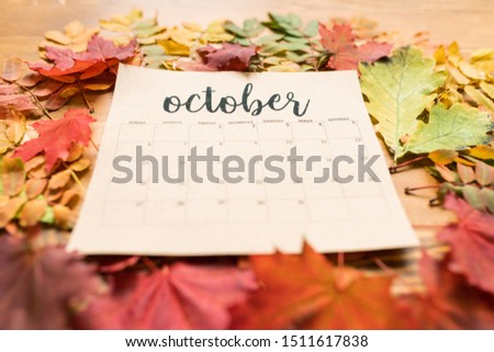 Autumn composition consisting of paper sheet of October calendar and leaves Stock photo © pressmaster