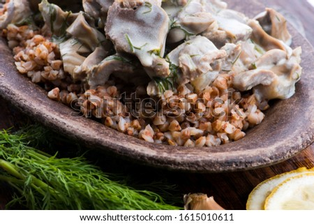 Stock photo: Stewed turkey stomachs with vegetables and buckwheat in a bowl