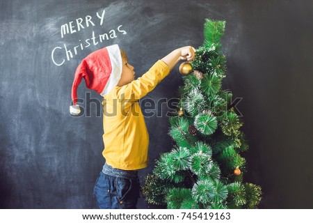 The boy wrote an inscription Merry Cristmas. Christmas tree. Xmas child and New Year holiday Stock photo © galitskaya