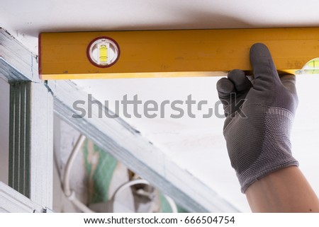 Gloved hands of professional repairman using equipment for gadget repair Stock photo © pressmaster