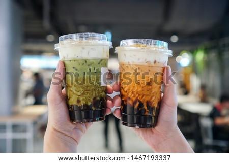 Bubble boba tea with milk and homemade tapioca and matcha pearls Stock photo © joannawnuk