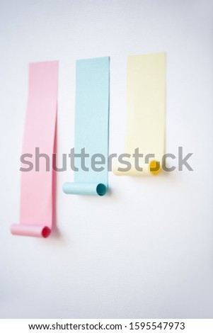 Chart made up of blue and smaller yellow notepapers stuck on screen of tablet Stock photo © pressmaster