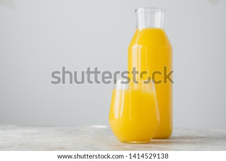 Horizontal shot of freshly squeezed orange juice made of citrus in glass containers, isolated over w Stock photo © vkstudio