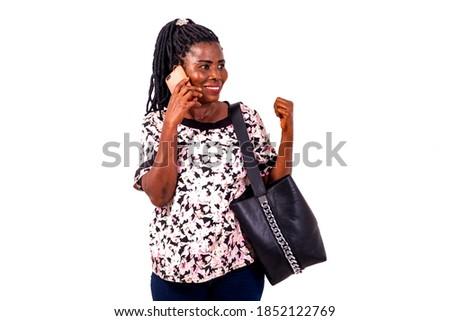 портрет удовлетворенный афроамериканец женщину мобильного телефона Nice Сток-фото © vkstudio