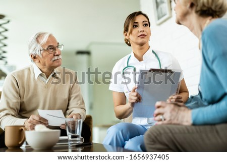 Low angle view of matured Caucasian male doctor and senior mixed race woman interacting with each ot Stock photo © wavebreak_media