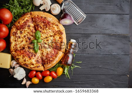 Fresh baked, hot american style pizza with all various ingredients on side Stock photo © dash