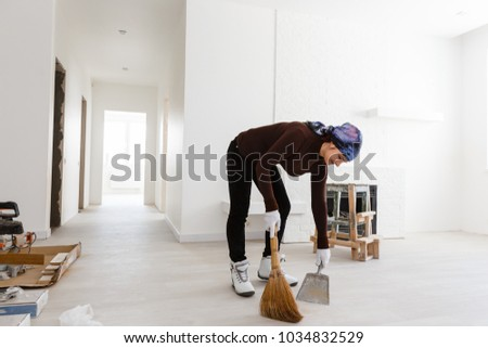 woman with brush and dustpan sweeping floor Stock photo © dolgachov
