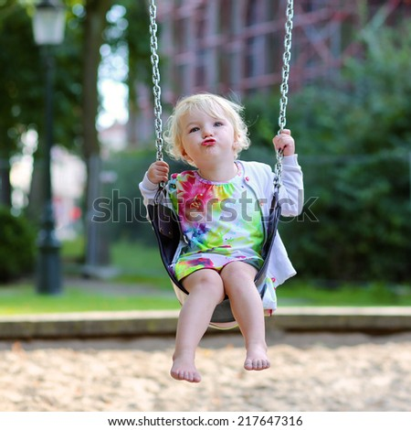 Baby girl has fun and plays on a sunny autumn day in the playground in a public park Stock photo © ElenaBatkova