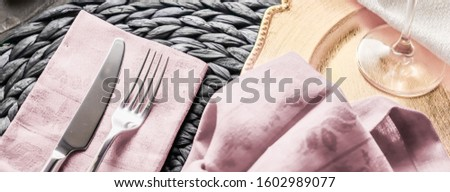Holiday table setting with pink napkin and silver cutlery, food  Stock photo © Anneleven