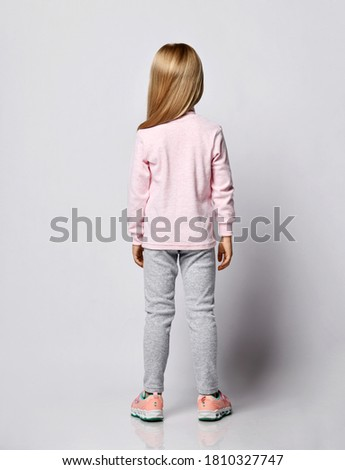 Image of blonde girl wearing warm sweater smiling and hugging he Stock photo © deandrobot