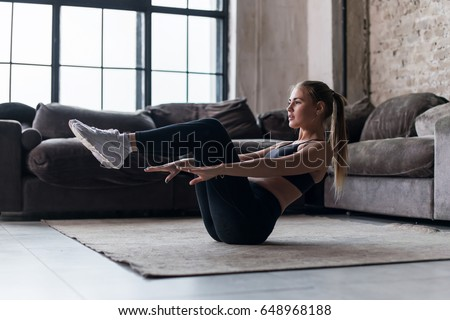 Fitness girl doing abs exercise to tone stomach muscles. Tiger curl reverse crunch planking bodyweig Stock photo © Maridav