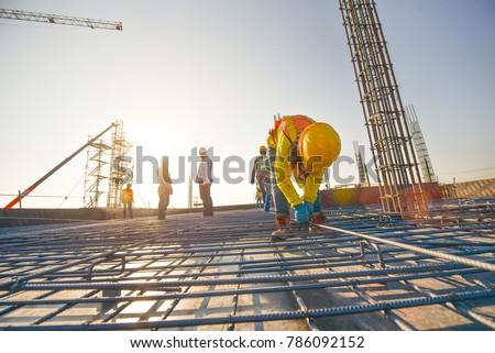Construction worker ties reinforcing steel Stock photo © deyangeorgiev