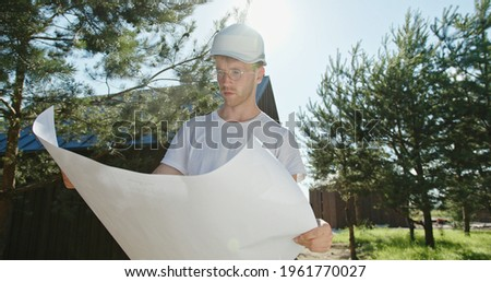 Builder unrolling plan Stock photo © photography33