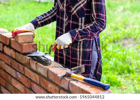 female bricklayer holding hammer stock photo © photography33