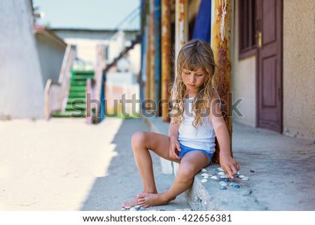 girl on a deserted beach in the background of an old rusty screw stock photo © ruslanomega