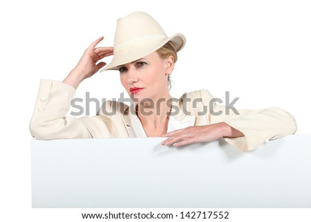 Woman in a cream suit and trilby with a blank board ready for your message Stock photo © photography33