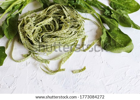 Raw spinach fettuccine pasta Stock photo © Klinker