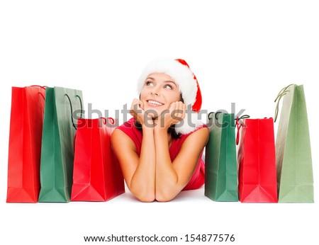 cheerful santa helper with shopping bags stock photo © dolgachov