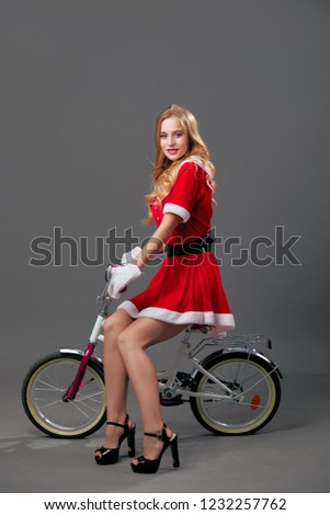 beautiful woman in santa claus costume running and looking back stock photo © deandrobot