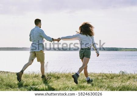 Hátsó nézet pár fut együtt tart szörfdeszkák Stock fotó © wavebreak_media