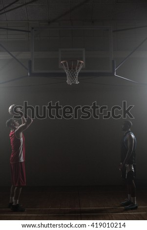 Two basketball player in a gymnasium with one scoring a shoot Stock photo © wavebreak_media