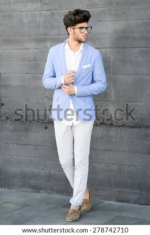 caucasian man wearing blue jacket white shirt and trendy hairsty Stock photo © zdenkam