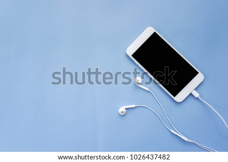 Blue wired earphones, top view Stock photo © magraphics