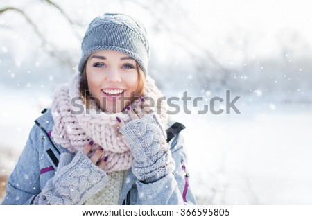 Beautiful happy woman wearing winter hat Winter forest and waterscape Stock photo © Lopolo