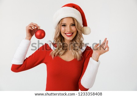 Emotional excited young cute snow maiden holding christmas toy. Stock photo © deandrobot
