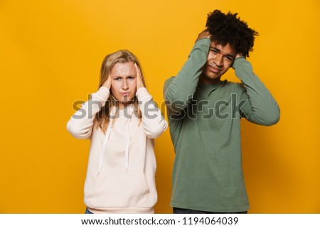 Photo of displeased couple man and woman 16-18 with dental brace Stock photo © deandrobot