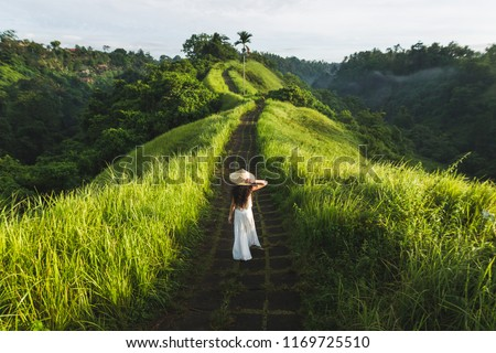 Young woman traveler in Campuhan Ridge Walk , Scenic Green Valley in Ubud Bali Stock photo © galitskaya
