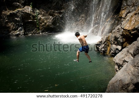 Stock photo: Wild man jumping in jungles