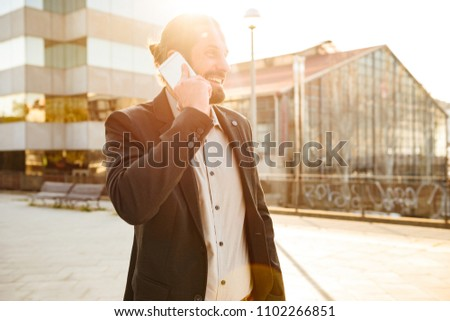 Closeup photo of sunlit businesslike man in suit laughing with h Stock photo © deandrobot