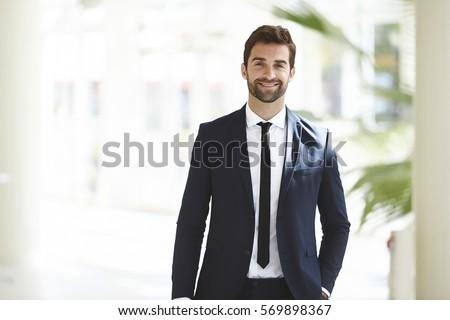 Stock fotó: üzletember · fiatal · áll · kezek · zseb · mosolyog