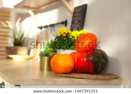 Little white modern kitchen with pumpkins on the wood worktop  Stock photo © dashapetrenko