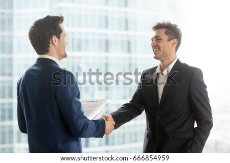 Business team two shaking hands after a meeting to sign agreemen stock photo © Freedomz