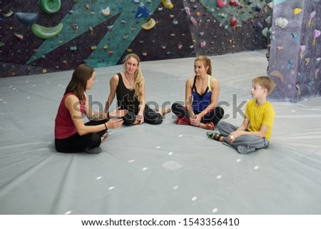 Group of young sporty people listening to their climbing instructor Stock photo © pressmaster